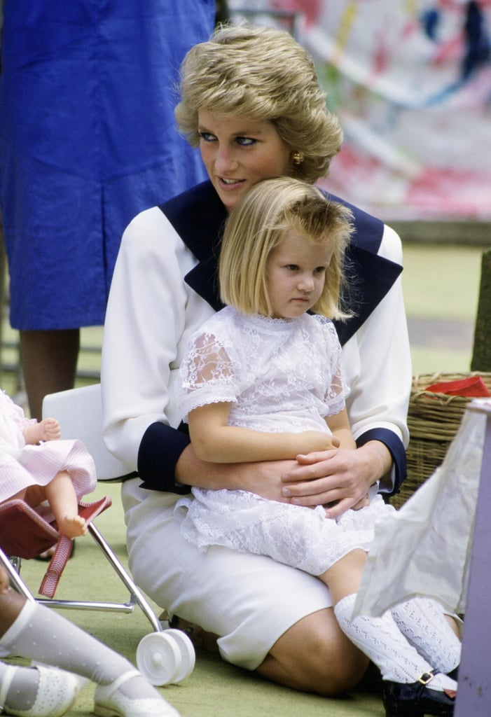 Diana let a little girl sit on her lap during her royal tour of Australia in February 1988.