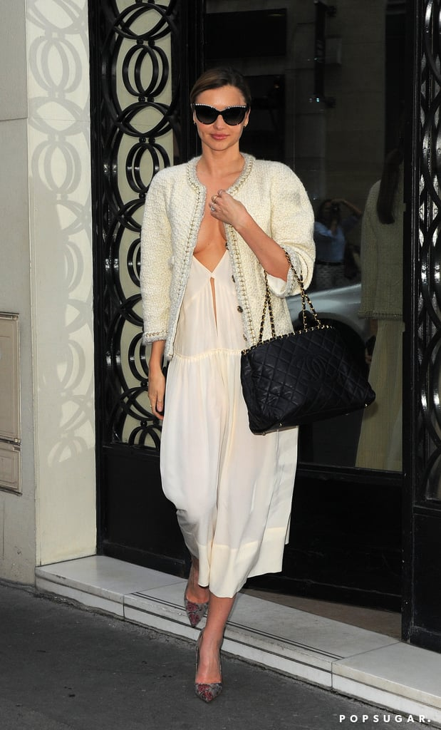 Later, Miranda kept the same dress on but changed up her outerwear to a sophisticated tweed jacket and switched her gray bag to a black quilted Chanel.