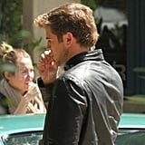 Liam Hemsworth wore a leather jacket.