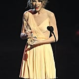 Taylor looked surprised while accepting a People's Choice Award in January 2011.