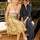 Mad Men ladies Elisabeth Moss and January Jones stuck by each other, Elisabeth in a ladylike fit-and-flare.