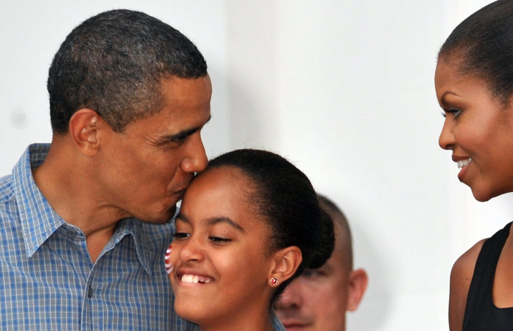 Barack gave Malia a sweet kiss on her birthday in 2009.