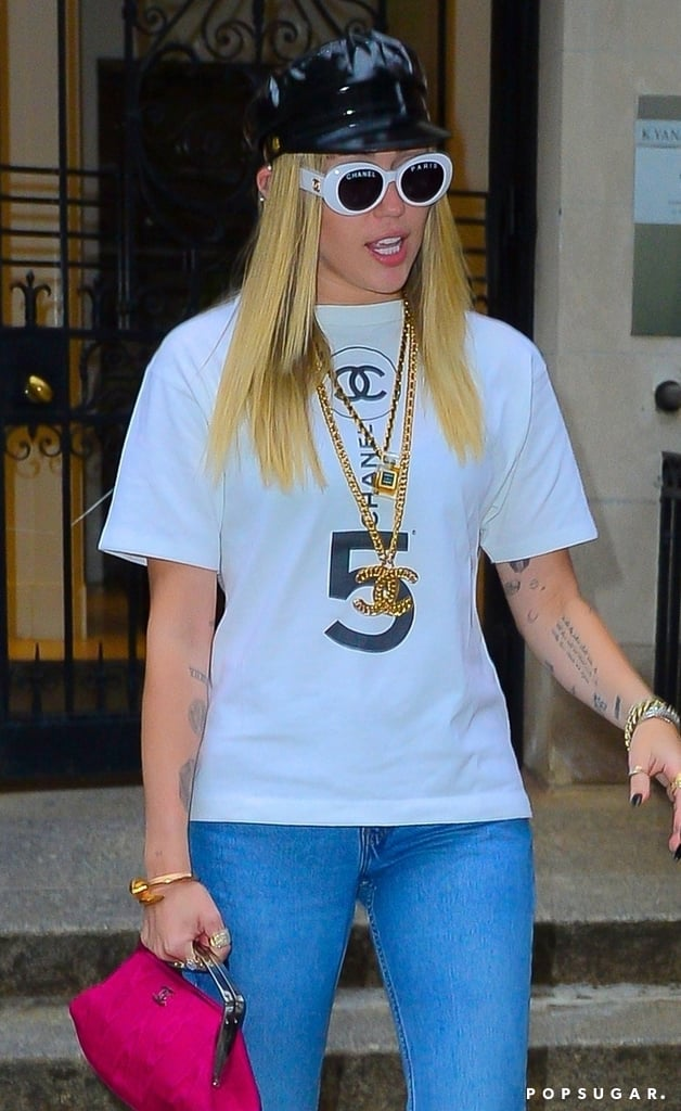 Miley Cyrus really stacked on the Chanel during a recent outing. What tipped us off? Oh, perhaps her round Chanel sunglasses, or her two gold Chanel necklaces, or the t-shirt with the brand name written plainly on the front — maybe that! Apart from wearing Saint Laurent to the 2019 Met Gala, the singer has been wearing Chanel pieces plenty lately, particularly since the passing of its longtime creative director Karl Lagerfeld.  While out in New York City on May 9, Miley dressed some of her luxurious accessories down with flared blue jeans and Converse sneakers. Even so, it wasn't enough to distract us from her pink Chanel handbag with silver hardware, which offered a nice pop of colour to the outfit. Ahead, see photos of Miley's humblebrag of an outfit, and scope out similar hot pink purses, because why not?      Related:                                                                                                           Couple Goals: Miley Wears Liam's Jacket to the Met Gala Afterparty