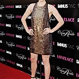 Amanda hit the Hollywood premiere in a hot bronze, embroidered, snake-effect Gucci mini-dress and completed the look with subtle but sexy ankle-strap sandals.