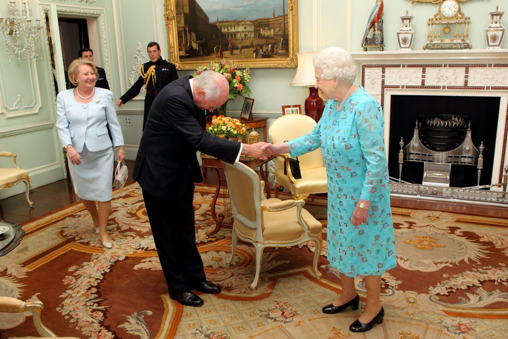 The queen shakes hands with former Australia Prime Minister John Howard and his wife before presenting him with the Order of Merit.