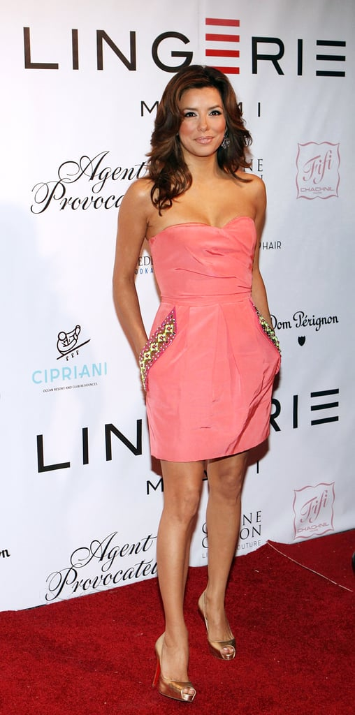 A coral Matthew Williamson strapless enhanced Eva's sun-kissed glow at a Miami charity event in February 2009. Mirrored Christian Louboutins complemented the colorful embellishments on her mini.