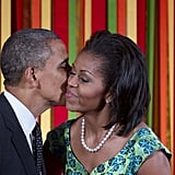 Barack gave Michelle a peck on the cheek.