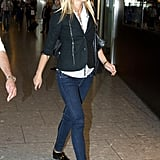 Gwyneth Paltrow walked to her flight at Heathrow airport.