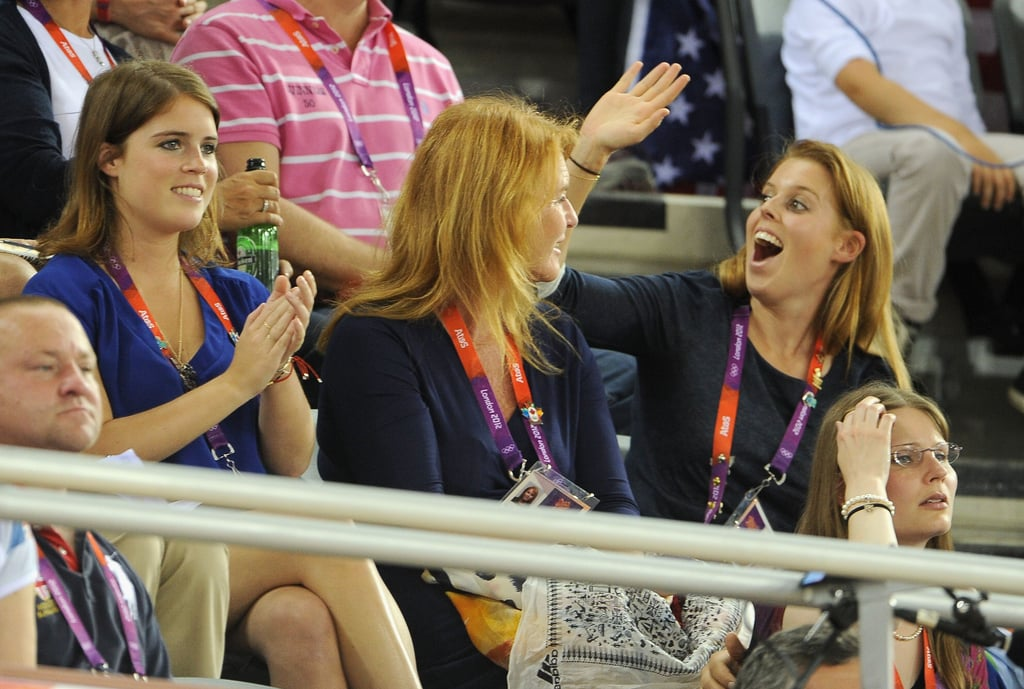Princess Beatrice waved to her cousin Prince Harry as she sat with her mother, Sarah Ferguson, Duchess of York, and her sister, Princess Eugenie.