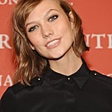 Karlie Kloss can do no wrong in our book. She wore smudged black eyeliner with an otherwise neutral makeup palette. Then, she topped it all off with soft waves.