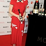 Carey also posed with a bottle of champagne.