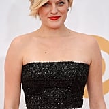 This tomato-red lipstick on Elisabeth Moss provided just the right amount of color to pair with her platinum coif and black and white Andrew Gn dress.