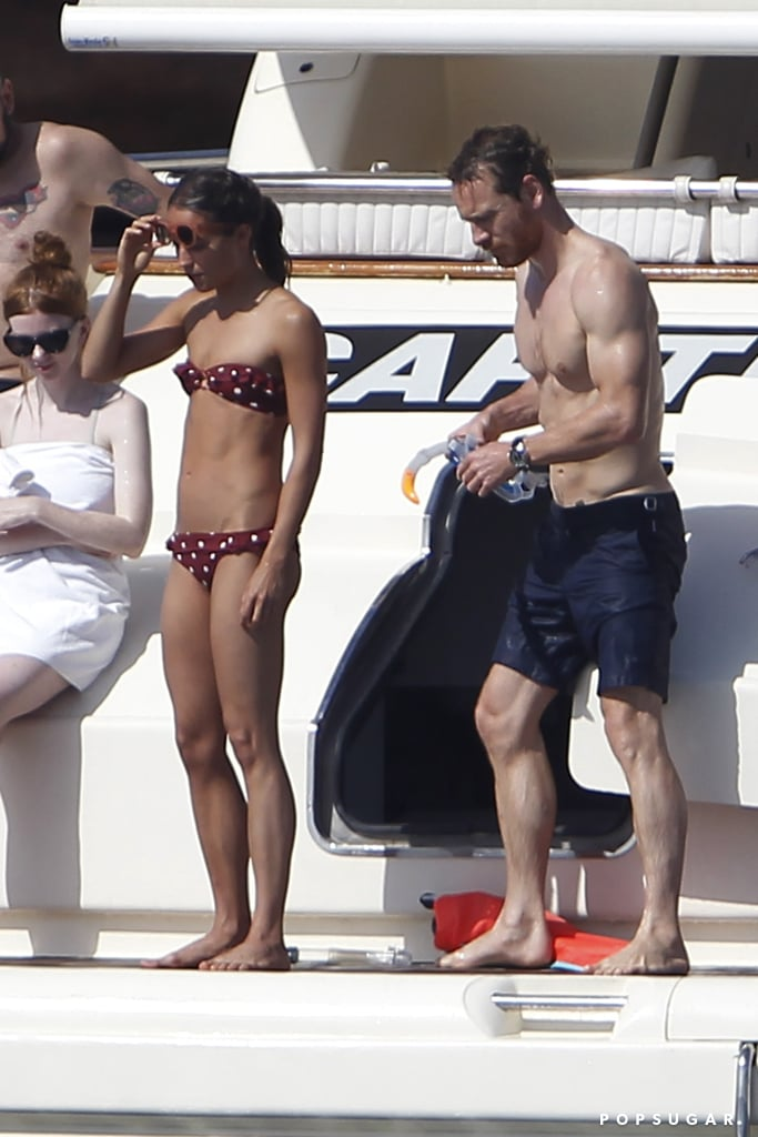 Michael Fassbender and Alicia Vikander caught some rays while relaxing on a boat in Formentera, Spain, on Wednesday. The Oscar winner was spotted diving into the ocean wearing a polka-dot bikini while Michael went shirtless to get a little sun on his biceps. The on-off couple has been dating since 2014 and made their first red carpet appearance together at the Venice Film Festival in 2016. Michael recently hit the big screen in Alien: Covenant, while Alicia has been hard at work on the forthcoming Tomb Raider reboot, which hits theaters in March 2018.       Related:                                                                                                           Michael Fassbender's 33-Step Guide to Seduction