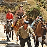 Locals led the girls around via mules in Greece.  Photo courtesy of The CW