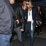 Jennifer Aniston wore a diamond ring at LAX with Justin Theroux.