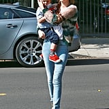 Miranda Kerr carried Flynn to a playdate in LA on Monday.