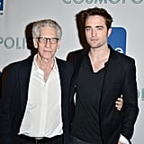 Director David Cronenberg and Robert Pattinson shared a hug.