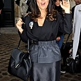 Salma Hayek  showed off her curves in a black and gray ensemble.