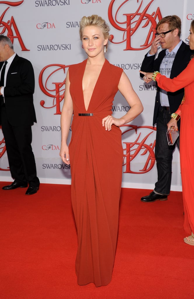 Julianne Hough arrived in a low-cut orange gown from Kaufman Franco.