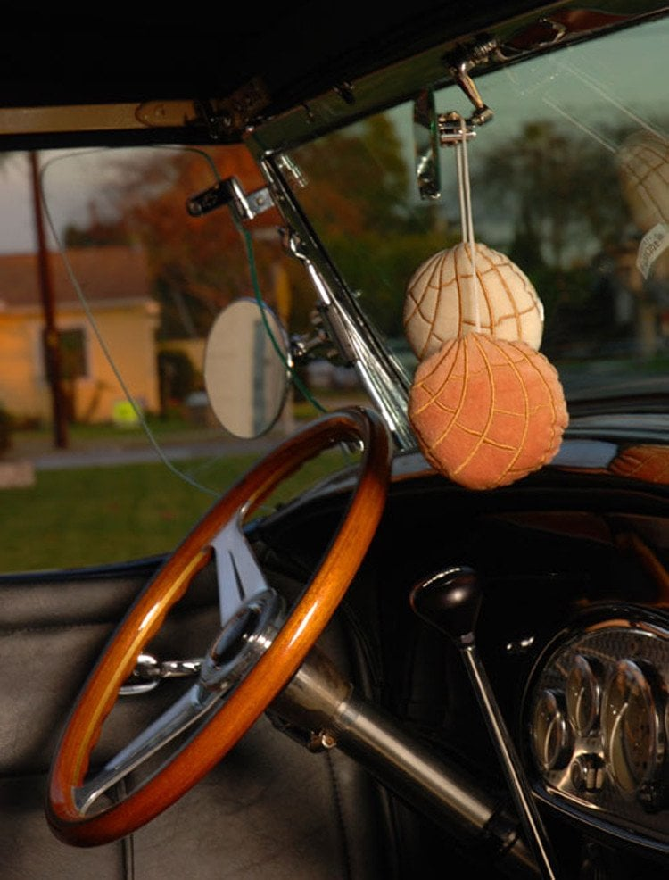 "Car mirror hangers to dress up your wheels. Concha ""Fuzzies"" Car Mirror Hangers ($9)"