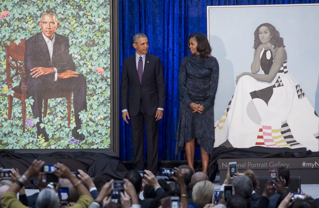 "A little over a year after departing the White House, Barack and Michelle Obama unveiled their official portraits at the Smithsonian's National Portrait Gallery on Feb. 12. Much like the former president's time in office, the portraits are unique and unprecedented in their use of prints, vibrant colors, and personality. Kehinde Wiley painted Mr. Obama's official portrait, while Amy Sherald painted that of Mrs. Obama. The two have made history as the first black artists to create official presidential portraits for the Smithsonian, with Wiley also being the first openly LGBTQ+ artist to do so. ""To call this experience humbling would be an understatement,"" the former president wrote on Instagram. ""Thanks to Kehinde and Amy, generations of Americans — and young people from all around the world — will visit the National Portrait Gallery and see this country through a new lens. They'll walk out of that museum with a better sense of the America we all love. Clear-eyed. Big-hearted. Inclusive and optimistic."" The unveiling ceremony was filled with many heartwarming moments, like when Mr. Obama stopped to just stare up at the former first lady's portrait. Ahead, enjoy every emotional picture from the historic event. Related: 44 Photos of Barack and Michelle Obama's Cutest Moments as America's Former First Couple"