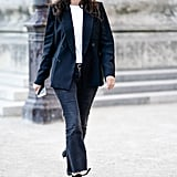 With a classic white tee and a blazer — then great heels