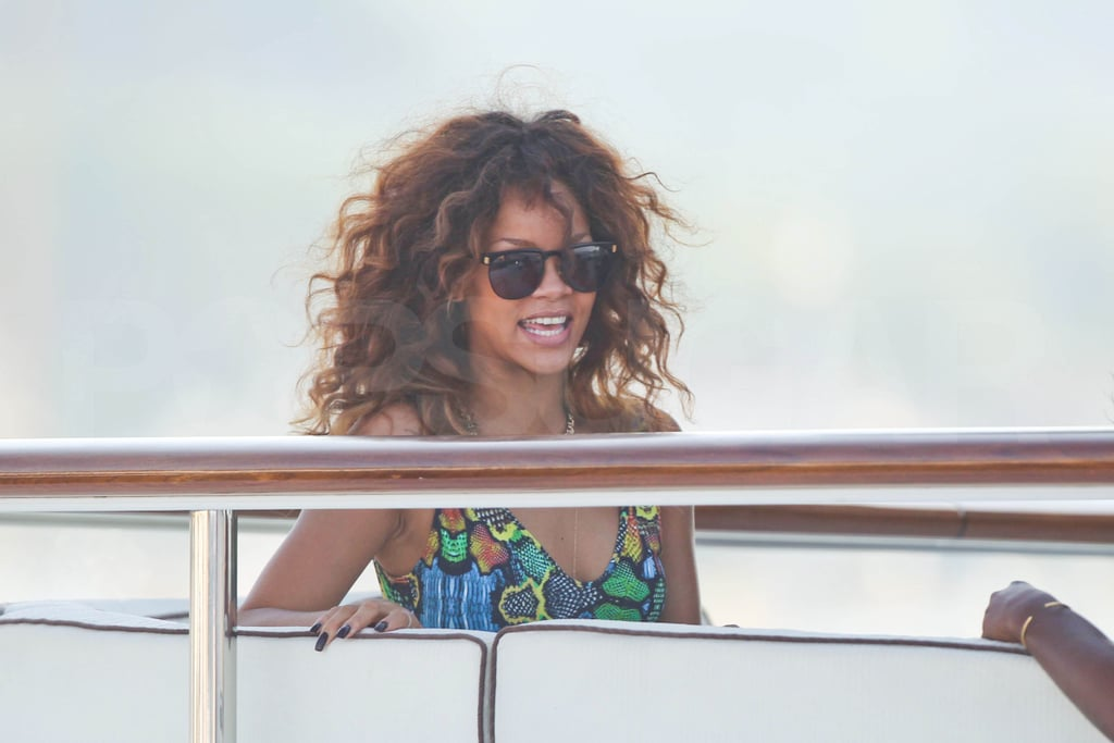 Rihanna let loose in a colorful cutout swimsuit.