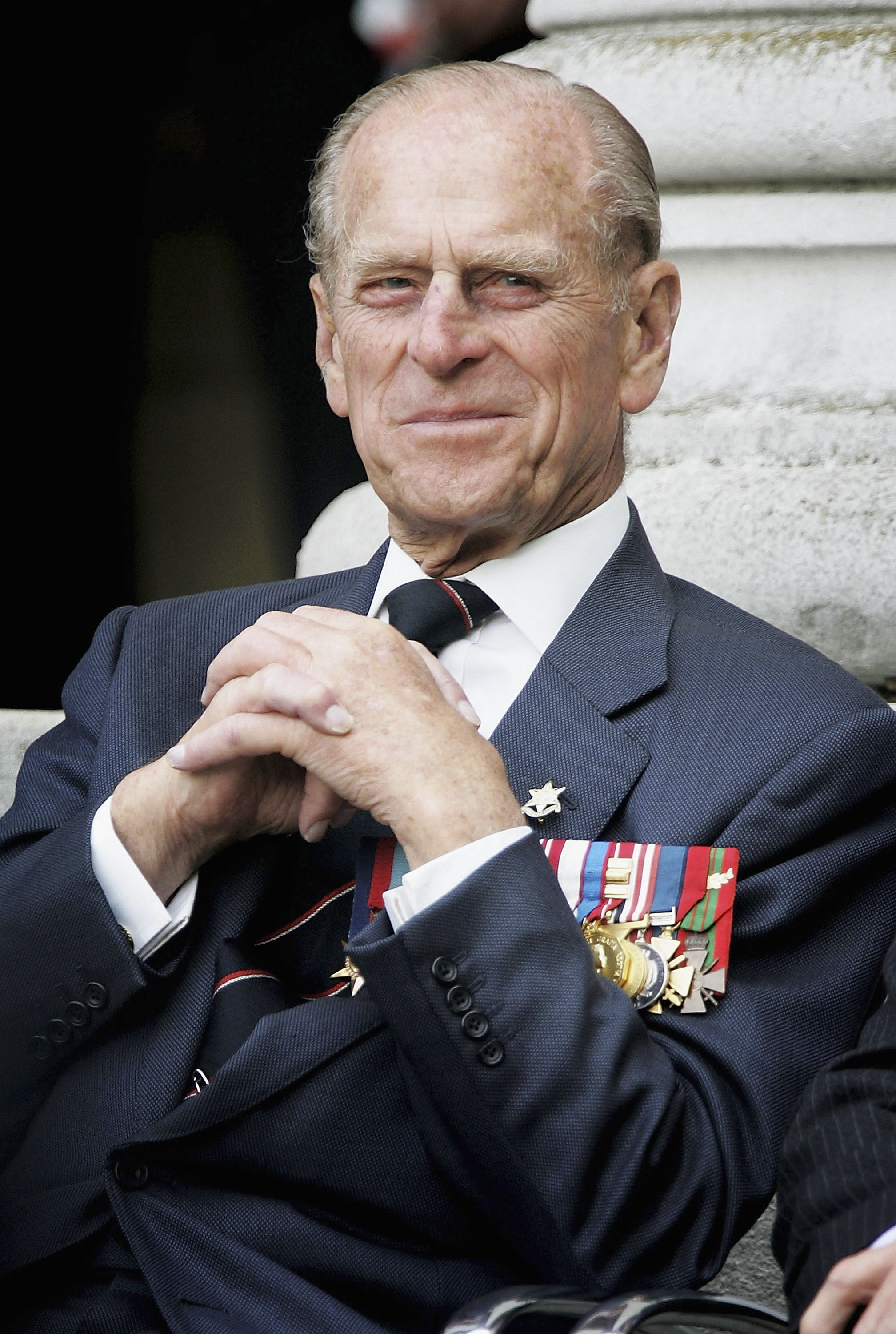 LONDON ? AUGUST 15: HRH The Duke of Edinburgh watches the Gurka band march past as World War II veterans gather to commemorate the 60th anniversary of VJ Day which marked the end of the war,  at the Imperial War Museum on  August 15, 2005 in London, England.  (Photo by Chris Jackson/Getty Images)