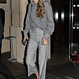 Gigi took her gray hoodie from The Row one step further by mixing it with a printed pair of H&M pants in the same shade. She slipped on an easy pair of Alexander Wang slides for comfort.