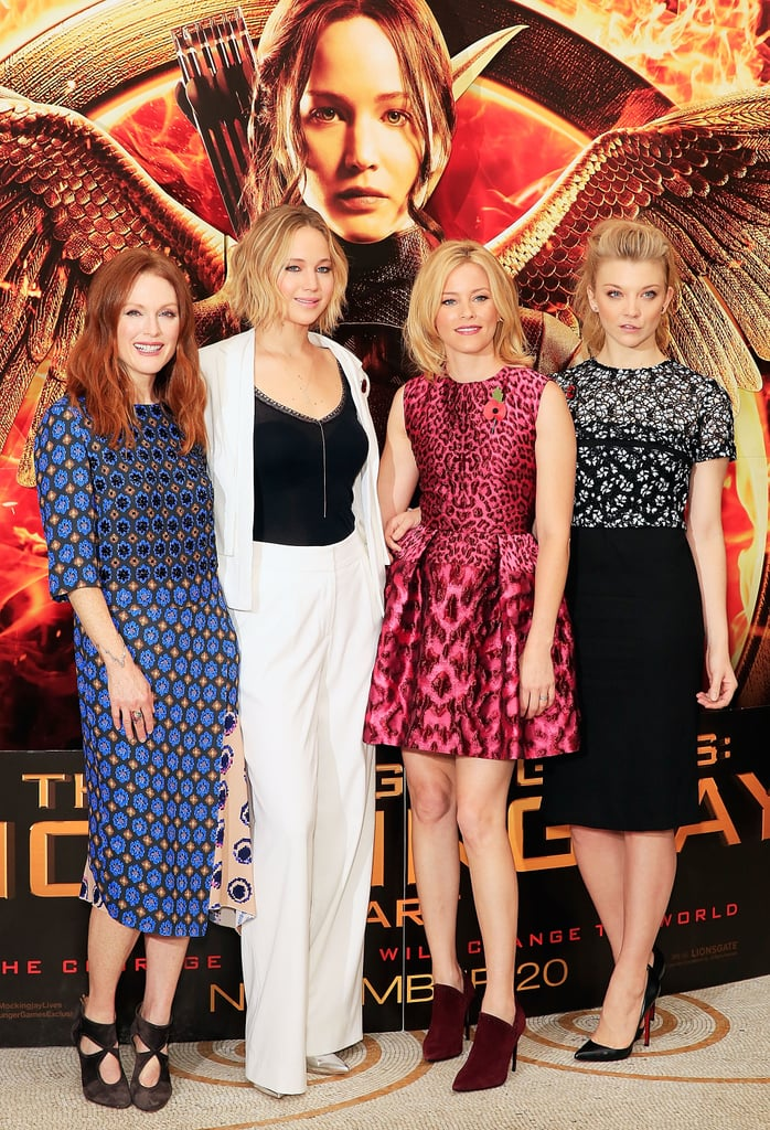 Jennifer Lawrence was joined by her costars (sans Josh Hutcherson) to promote The Hunger Games: Mockingjay — Part 1 in London on Sunday. The cast was reunited at a photocall, where they all posed for photographs together ahead of the film's London premiere. Jennifer joked around with Julianne Moore, Elizabeth Banks, and Natalie Dormer while taking snaps in a chic white suit. Josh was sadly missing from the group, as he is still recovering from strep throat. Jennifer is also still battling strep throat although she was well enough to attend a taping of Wetten Daas with Liam Hemsworth in Berlin on Saturday. The cast still have a long promotional tour ahead of them as they gear up for the release of their highly anticipated film.