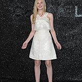Ella Fanning arrives in white to Chanel.