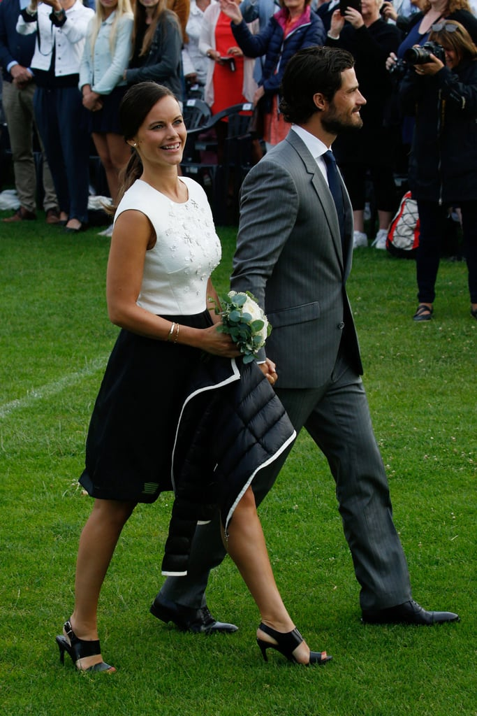Tuesday was a special day for the Swedish royal family — they celebrated Crown Princess Victoria's 38th birthday! After an adorable appearance from Princess Estelle during the day, all eyes were on newlyweds Prince Carl Philip and Princess Sofia at a concert that same evening. It was the couple's first public outing since they got married in June and took a romantic honeymoon on a private island in Fiji. Both Sofia and Carl Philip were beaming at the event — which was also Sofia's first official appearance as a princess — as they joined family members to enjoy the show. Scroll through to see their newlywed glow, and then take a look back at their PDA-filled wedding pictures!