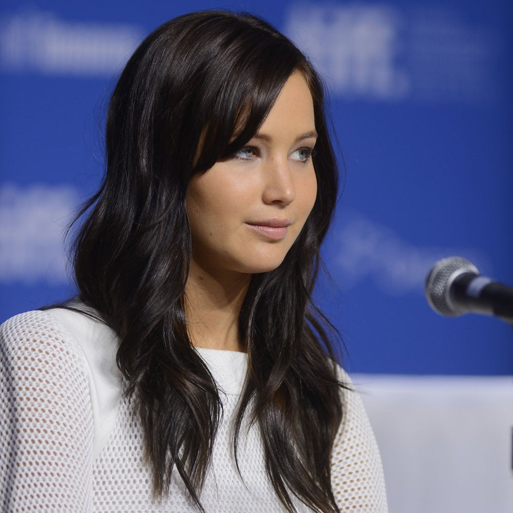 Rocking a more casual look at the press conference yesterday, we loved Jennifer's dark hair against her white dress.