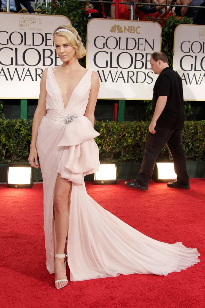 Charlize showed some leg in a Dior dress at the Golden Globes in January 2012.