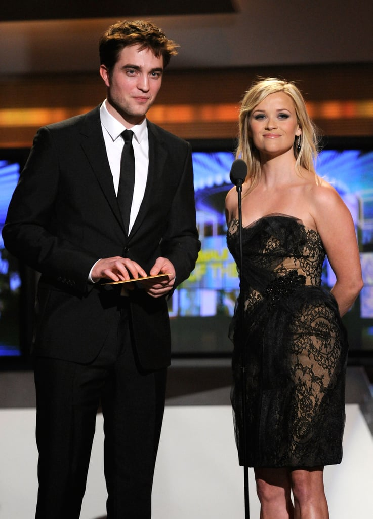 Robert Pattinson and Reese Witherspoon had an exciting day that started with their Water For Elephants junket in LA and ended with the duo presenting Miranda Lambert with the female vocalist of the year statue at the Academy of Country Music Awards in Las Vegas! We sat down with Rob this morning and he shared real-life risks he has taken for romance, the responsibility of portraying Jacob, and what he'd like to do to the people leaking Breaking Dawn pictures and videos. One week after her lavish wedding ceremony Reese was back in promotional mode and wearing her new wedding band when she chatted with our lucky winner of I'm a Huge Fan — stay tuned for their interview! Rob and Reese skipped the red carpet before the show, but they'll be back in front of the cameras in two weeks at the April 17 NYC premiere of their must see movie.