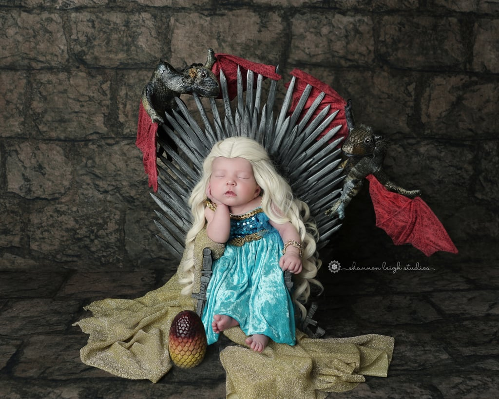"Game of Thrones mania is so, so real these days, thanks to season eight finally airing, but it was nearly two years ago, after the end of season seven, that photographer Shannon Leigh, of Shannon Leigh Studios received her first request for a GoT-themed newborn session. ""We were so excited when we had a client ask for a Game of Thrones-themed shoot,"" Shannon told POPSUGAR. ""My hubby and I run our photography studio together right outside of Atlanta, GA. I'm the photographer, and he does all the other things that need to be done. We are both creative people, so we have fun coming up with these themes, AND we're big GoT fans."" But this was no simple shoot featuring a baby wearing a Game of Thrones onesie with a stuffed dragon as a prop — this was a serious shoot, featuring the smallest replica of the Iron Throne (and it led to four additional Game of Thrones shoots!). ""My hubby made the amazing Iron Throne out of wood — he carved out all the swords and handles, and it's only 24 inches tall! We do newborn sessions when they're 6 to 14 days old, so the babies are tiny!"" Tiny or not, these babies are for sure the real heirs to the Throne. See all of the adorable Jons and Danys ahead, and check out Shannon's Etsy shop for a digital version of the backdrop Shannon uses in her GoT shoots if you want to photograph your own little king or queen!      Related:                                                                                                           These 6 Game of Thrones Baby Names Are Gaining Popularity in 2019"