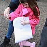 Suri Cruise held onto a menu from Sugar and Plumm in NYC.