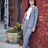 On Marina: Argent pantsuit, Uniqlo top, and Kenneth Cole sneakers.