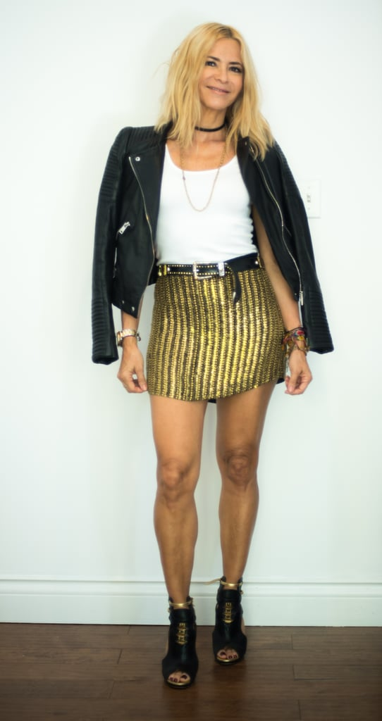 With A Gold Miniskirt A Black Leather Jacket And Black Heels