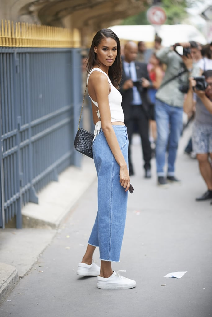 Slip into a pair of cropped denim and some trusty trainers.