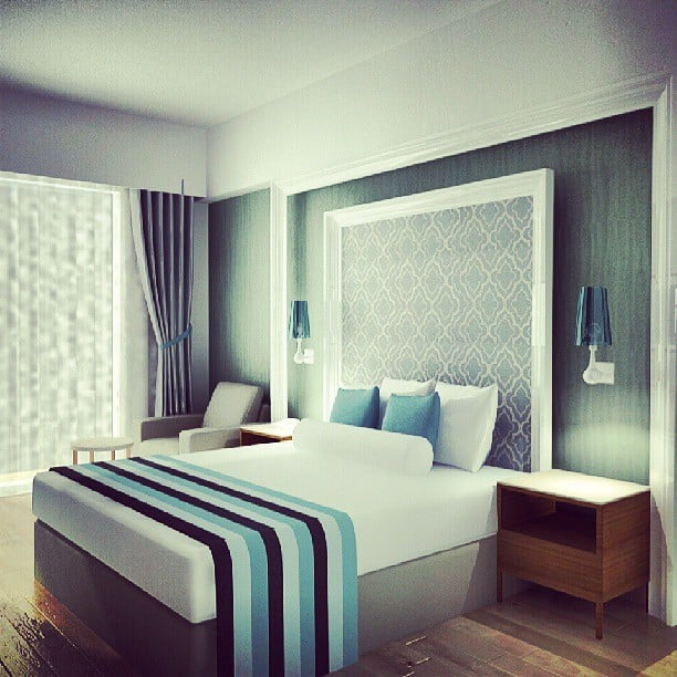 Try framing wallpaper or fabric for an art piece/headboard hybrid. Source: Instagram user damladamish