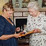 Queen Elizabeth II and Dame Judi Dench