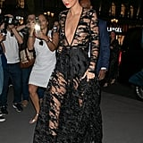 Kendall stepped out in Paris wearing this gorgeous sheer, detailed black dress.