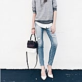 An Elevated Sweatshirt Over a Button-Down With Jeans and Heels