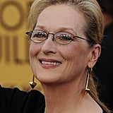 Meryl Streep's swinging Fred Leighton earrings played up the fierce factor of her black Lanvin dress.