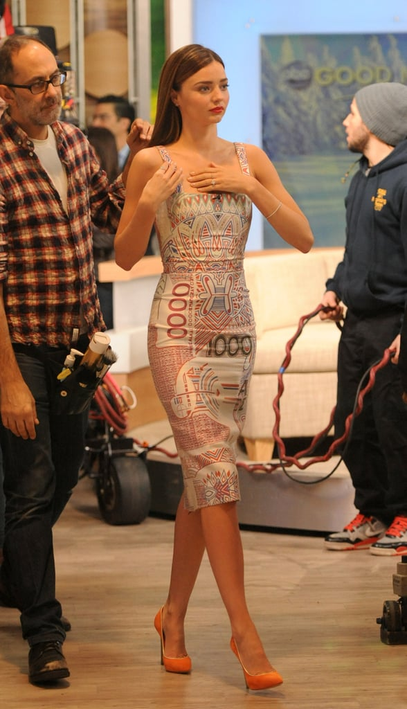 During her Good Morning America appearance in NYC, Miranda got print-happy in a printed knee-length, square-neck dress and orange Casadei pumps.