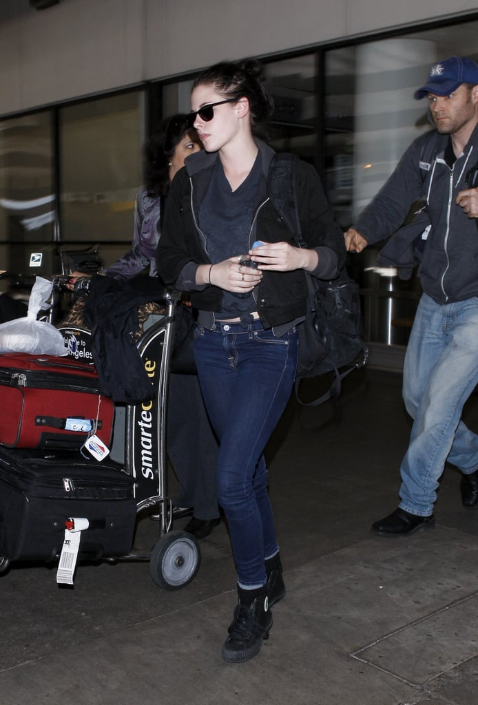 Kristen Stewart arrived back at LAX last night following a whirlwind trip to Paris. She spent less than a week in France, but nonetheless managed to work with some of fashion's biggest names while there. Kristen donned a ball gown for a photo shoot lensed by Mario Testino that's apparently bound for Vanity Fair. Additionally, she spent a couple of hours chatting with Chanel's Karl Lagerfeld at a café. All the press is being done well ahead of her blockbuster Snow White and the Huntsman's release on June 2. There was time for some non-work fun, too. Kristen shopped at the childrens' boutique Bonpoint, and met up with friends at Café Germain. A sushi lunch was also on the initerary for Kristen at Hanawa, a restaurant Gwyneth Paltrow recently tweeted about loving.