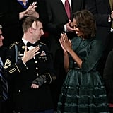 Michelle gave US Army Ranger Sgt. First Class Cory Remsburg a hearty round of applause.