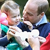 William made Charlotte crack a smile at a children's party for military families.