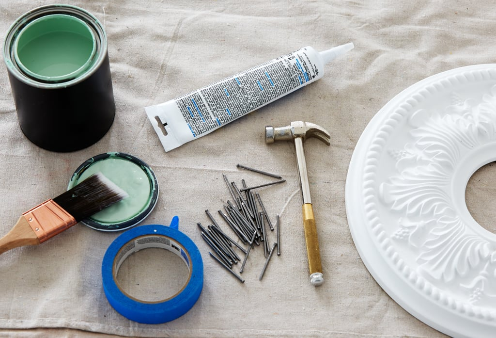 "Here's What You'll Need  1 quart semigloss paint (I used Benjamin Moore, Spruce Green) Finish nails (I used 2"") Paintable caulk Hammer Painter's tape Faux-plaster ceiling medallion (mine are 14"" in diameter) Dummy doorknob (one per medallion)"